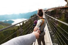 Free Woman With Yellow Backpack Standing On Hanging Bridge With Trees Royalty Free Stock Image - 118920736