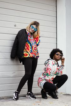 Free Women Wearing Multicolored Pullover Hoodie And Black Jacket Stock Photo - 118920750