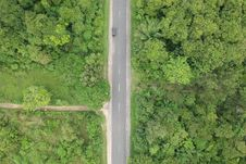 Free Aerial Photo Of Black Vehicle On Grey Concrete Road Between Forest Stock Photography - 118920762