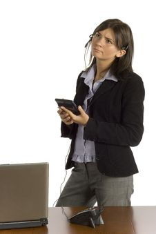 Free Female Office Worker With Calculator - Thinking Royalty Free Stock Photos - 1194478
