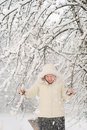 Free Young Woman Shaking Snowy Tree Royalty Free Stock Photo - 11907395