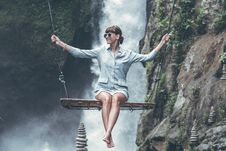 Free Photo Of Woman Riding Swing In Front Of Waterfalls Royalty Free Stock Image - 119007916