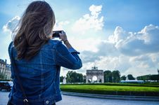 Free Woman Wearing Blue Denim Jacket Standing While Holding Smartphone Stock Photo - 119007920