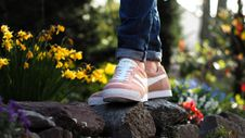 Free Person Wearing Pink Nike Low-top Sneakers Stepping On Stone Surrounded By Flower Royalty Free Stock Photo - 119007955