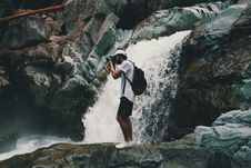 Free Man Wearing White T-shirt Holding Dslr Camera Near Waterfall Royalty Free Stock Images - 119061759