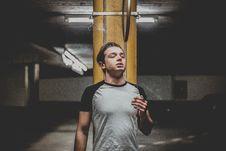 Free Man Wearing Gray And Black Raglan T-shirt Standing Near Orange Post Stock Photo - 119061790