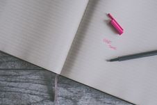 Free Pink Ballpoint Pen On White Ruled Paper Stock Photos - 119061813