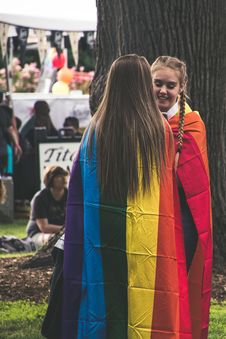 Free Photo Of Two Woman Wearing Rainbow Capes Stock Photography - 119196852