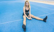 Free Woman Wearing Black Sports Bra And Black Shorts Sitting On Ground Stock Image - 119196871