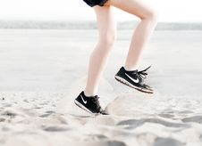 Free Photo Of Woman Wearing Pair Of Black Nike Running Shoes Stock Photography - 119196882