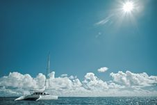 Catamaran On Calm Green Shallow Waters Royalty Free Stock Photography