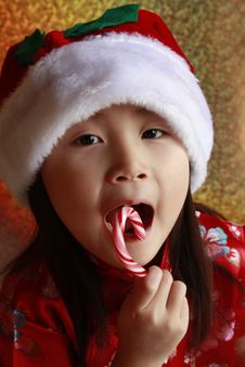 Asian Girl With Candy Cane Stock Image