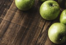 Free Four Granny Smith Apples Stock Photography - 119308582