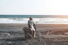 Free Woman Riding Motor Scooter On Seashore Royalty Free Stock Photos - 119308588