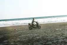 Free Man Riding Black And Gray Motor Scooter On Beach Stock Photography - 119308592