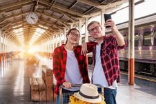 Free Man And Woman At The Train Station Taking A Selfie Stock Photo - 119308750