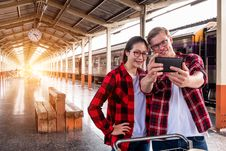 Free Man And Woman Taking Selfie Near Gray Train Royalty Free Stock Images - 119308789