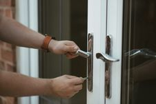 Free Person Holding Door Lever And Key Stock Photos - 119308823