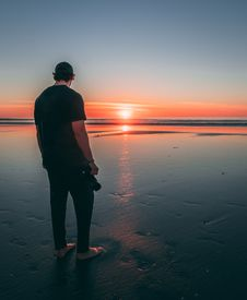 Free Man Standing On Beach During Sunset Stock Photos - 119467333