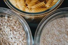 Free Three Clear Glass Jars With Cereals Stock Image - 119467411