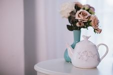 Free White Ceramic Teapot Near Flower Arrangement On White Surface Stock Photos - 119467503