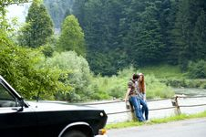 Free Man And Woman Sitting On Road Gutter Royalty Free Stock Photography - 119467617