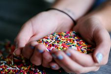Free Person Holding Full Of Sprinkles Royalty Free Stock Image - 119467736