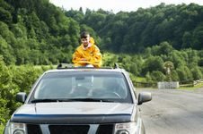 Free Child In Yellow Jacket Sitting On Roof Of Nissan Frontier Through The Sunroof Royalty Free Stock Photos - 119554058