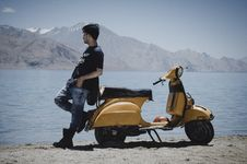 Free Photo Of Man Leaning On Motorcycle Stock Photo - 119554070