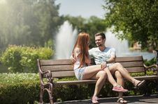 Free Man And Woman Sitting On A Bench Stock Photo - 119554120