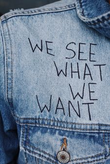 Free Blue Denim Collared Top With We See What We Want Text Overlay Royalty Free Stock Images - 119554149