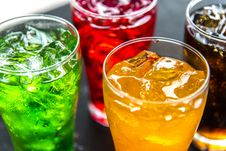 Free Four Clear Drinking Glasses Filled With Beverages Stock Photo - 119554160