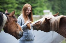 Free Close-Up Photography Of Woman Near Horses Stock Photos - 119554173