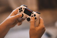 Free Person Holding Sony Ps4 Controller Stock Image - 119554181