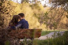 Free Photography Of Couple Sitting On Bench Stock Image - 119554221