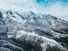 Free Mountains Covered In Snow Under Cloudy Sky Stock Photography - 119611272