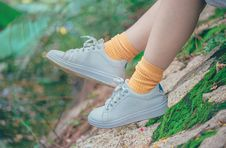 Free Person Wearing White Plimsoll Shoes Stock Image - 119611341