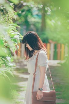 Free Woman Wearing White Crew-neck Short-sleeved Dress Standing Beside Green Leaf Plant Stock Photos - 119611353