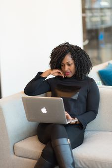 Free Woman In Black Outfit With MacBook Sitting On A Couch. Royalty Free Stock Photography - 119611407