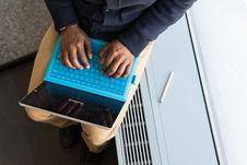 Free Person Typing On Blue Laptop Computer Stock Photos - 119611413