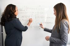 Free Two Women Writing On Dry Erase Board Stock Photo - 119666410