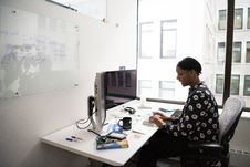 Free Woman Sitting In Front Of Computer Monitor Royalty Free Stock Photos - 119666478