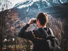 Free Man Using Black Binoculars Near Forest Trees At Daytime Royalty Free Stock Image - 119735166