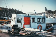 Free Fishing Boat On A Dock Stock Photography - 119735182