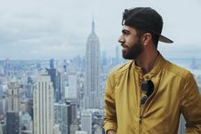 Free Portrait Photo Of Man In Yellow Zip-up Jacket Near Empire State Building Stock Photography - 119735192