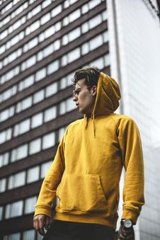 Free Photography Of Guy Wearing Yellow Hoodie Royalty Free Stock Photos - 119735208