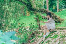 Free Photography Of Woman Sitting On Rock Royalty Free Stock Photos - 119735258