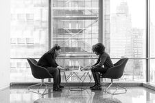 Free Two Person Seating On Chairs Stock Images - 119844614