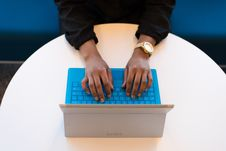 Free Person Typing On A Laptop Stock Image - 119844631