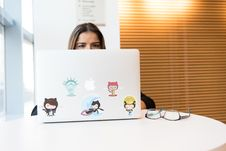 Free Woman Sitting In Front Of Laptop Stock Photos - 119844693